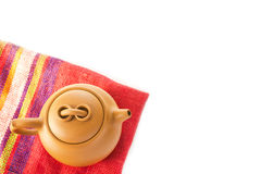 Chinese Yixing clay teapot. Colorful red fabric napkin / cloth u Royalty Free Stock Image