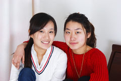 Chinese young beautiful woman - friendship. Two young beautiful woman - friendship hugging each other Royalty Free Stock Photography