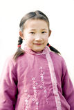 Chinese young girl. With tradition clothes and a pair of plaits,background is pure white Stock Photography