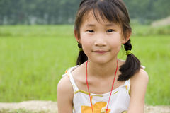 Chinese young girl. With  pigtail Stock Images