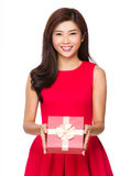Chinese young girl hold with gift box. Isolated on white background Stock Image
