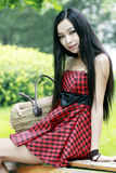 Chinese young girl outdoor. Chinese young girl relaxing outdoor Stock Images