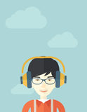 Chinese young guy with headphone Royalty Free Stock Image