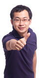 Chinese Young Man. Chinese young male smile with thumb up Royalty Free Stock Images