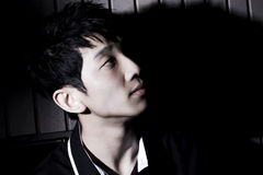 Chinese young man. In black Stock Images