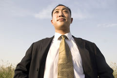 Chinese young man. In suit under sky Stock Image