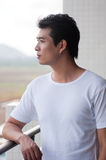 Chinese young man. A young and handsome chinese man wear white t-shirt stock photos