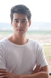 Chinese young man. A young and handsome chinese man wear white t-shirt royalty free stock photos