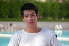 Chinese young man. A young and handsome chinese man wear white t-shirt stock images