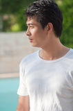 Chinese young man. A young and handsome chinese man wear white t-shirt royalty free stock photography