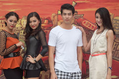 Chinese young models. Four Chinese young models show in front of a art painting background stock images