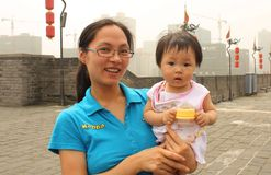 Chinese young woman with her baby Stock Image