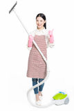 Chinese young woman with a vacuum cleaner Stock Photos