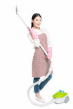 Chinese young woman with a vacuum cleaner Royalty Free Stock Photos