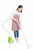 Chinese young woman with a vacuum cleaner Royalty Free Stock Images