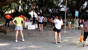 Chinese young women dance and exercise stock video