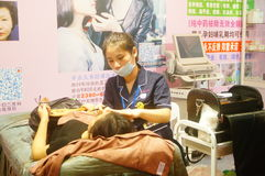 Chinese young women are having facial beauty or plastic surgery stock photos