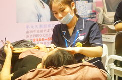 Chinese young women are having facial beauty or plastic surgery royalty free stock photos