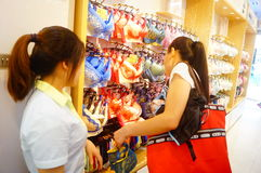 Chinese young women in the purchase of underwear Royalty Free Stock Photo