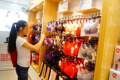 Chinese young women in the purchase of underwear Stock Images