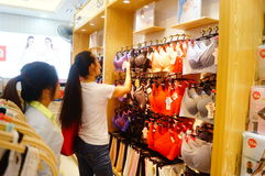 Chinese young women in the purchase of underwear Royalty Free Stock Photos