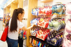 Chinese young women in the purchase of underwear Stock Photos