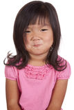 Chinese youth pouty. A Chinese girl has a funny expression on her face Royalty Free Stock Photography
