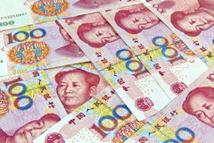 Chinese Yuan. Chinese 100 Yuan bill face within pile of other 100 Yuan bills royalty free stock photography