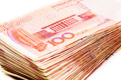 Chinese yuan bank note currency. Pile of chinese yuan bank notes on white background Royalty Free Stock Images
