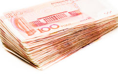 Chinese yuan bank note currency. Pile of chinese yuan bank notes on white background Royalty Free Stock Image