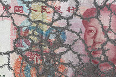 Chinese Yuan bank note on eroding ground Royalty Free Stock Images