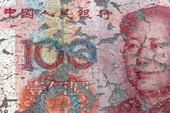 Chinese Yuan bank note on eroding ground Stock Photos