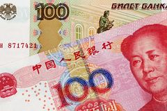 Chinese 100 Yuan Bank Note With 100 Russian Ruble bank note. A close up image of a 100 Chinese yuan bank note with a 100 Russian ruble bank note royalty free stock photography