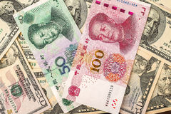 Chinese yuan bank note on USA dollars background Royalty Free Stock Photography