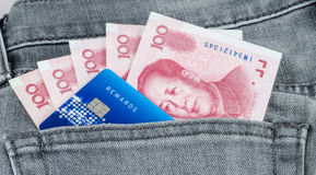 Chinese yuan banknote and credit card in the grey jean pocket Royalty Free Stock Image