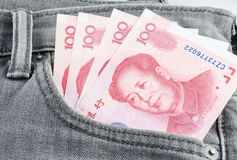 Chinese yuan banknote in the grey jean pocket Royalty Free Stock Photos