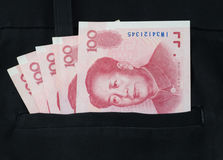 Chinese yuan banknote in the trousers pocket Stock Photo