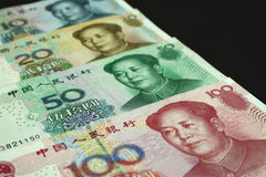 Chinese Yuan Banknotes. Chinese yuan notes of various amounts (shallow depth of field