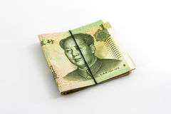 Chinese yuan banknotes rolled up with rubberband. Chinese yuan banknotes rolled up with rubberband on white background Royalty Free Stock Images