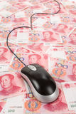 Chinese Yuan and Computer Mouse Stock Photos