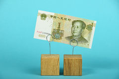 Chinese yuan decline illustrated over blue Royalty Free Stock Photo