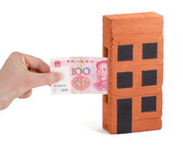 Chinese Yuan deposit. Chinese Yuan bank note being inserted to or drawn from a block of flats Stock Image