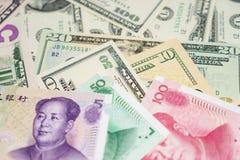 Chinese yuan en ons dollar Stock Afbeelding