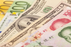 Chinese yuan, European euro notes and American dollars stock images
