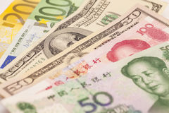 Chinese yuan, European euro notes and American dollars. Isolated royalty free stock image