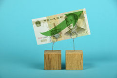 Chinese yuan growth illustrated over blue Royalty Free Stock Images