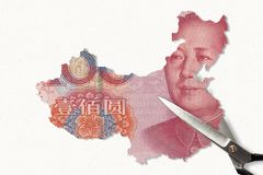 Chinese Yuan map. And scissors royalty free stock photo