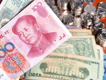 Chinese Yuan note in front of US Dollar notes Stock Image