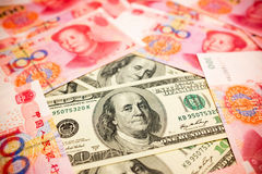 Chinese Yuan Note and U.S. dollar background Royalty Free Stock Photo