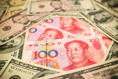 Chinese Yuan Note and U.S. dollar background Stock Images